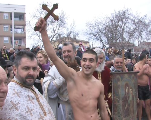 A person who pulled out the cross on Theophany Bulgarian tradition