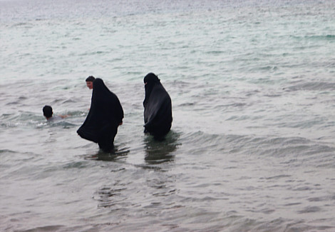 Arab woman swimming in Burkas in Arab Sea, United Arab Emirates