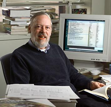 Dennis Ritche near a personal computer picture