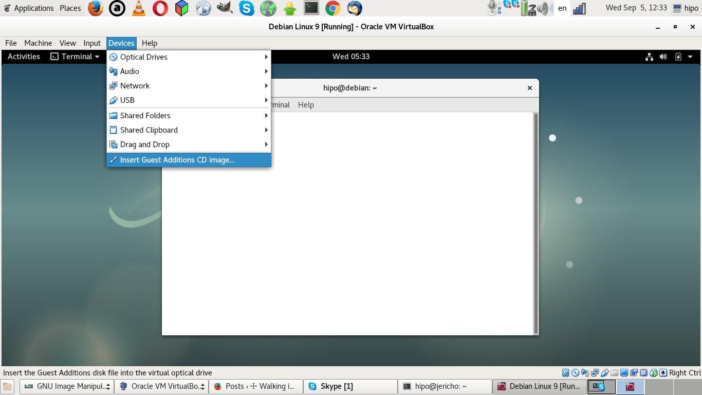 virtualbox-VM-enable-insert-guest-additions-CD-image-menu-screenshot-debian-linux