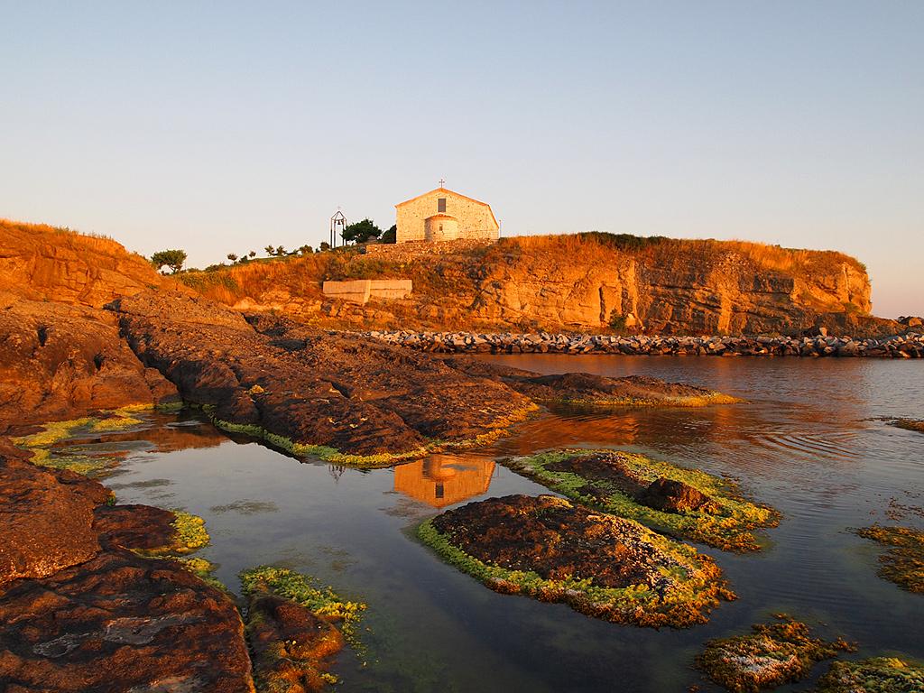Water Dunes Dormition of Theotokos Church on rocks view
